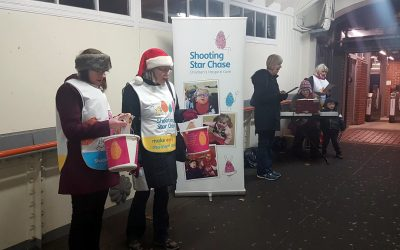 Carol Singing at Weybridge Station – Fundraising for Shooting Star Chase Children's Hospices