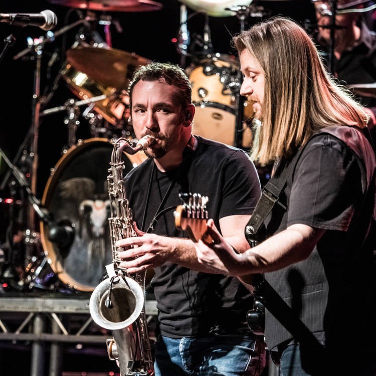 Illegal Eagles in Concert at GLIve Guildford - Sax & Guitar