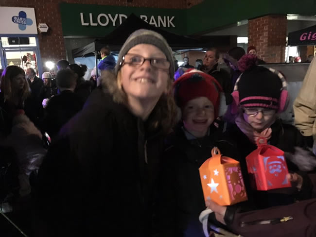 Children with lanterns at Weybridge Town Business Groups Christmas Tree event