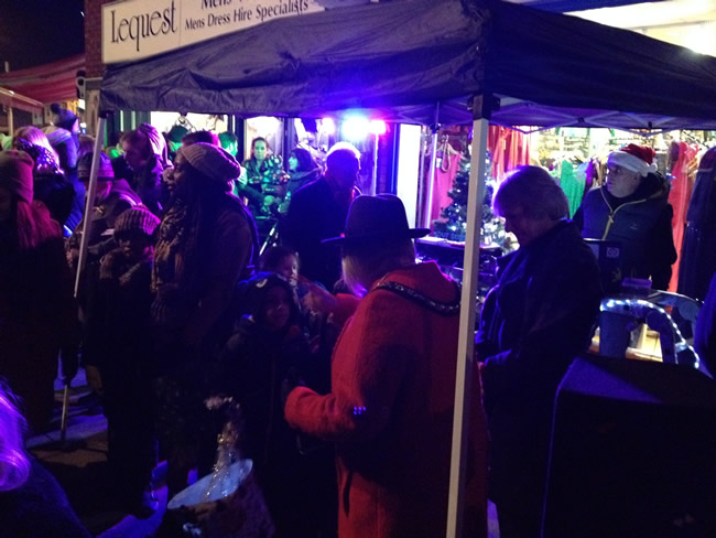 Families gather outside Lequest to see the Weybridge Town Christmas Tree Lights Switched On By The Deputy Mayor Supported by Posh Pawn Star Ian Michael Towning