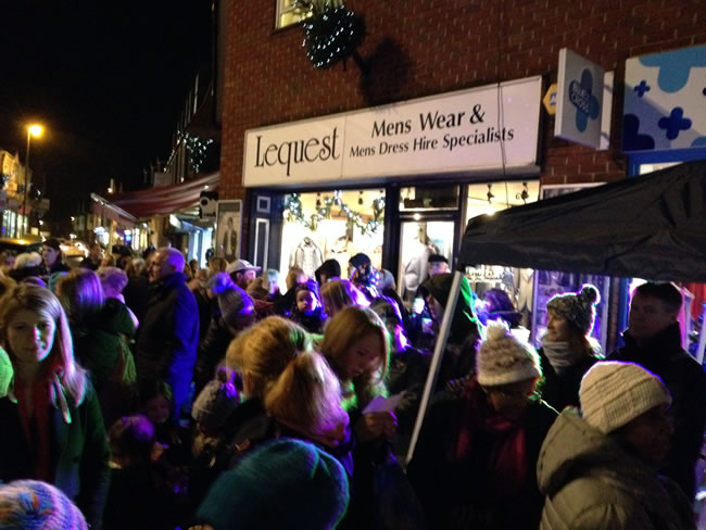 Families gather for The Mayor and Posh Pawn Star to Switch Weybridge Town Christmas Lights On
