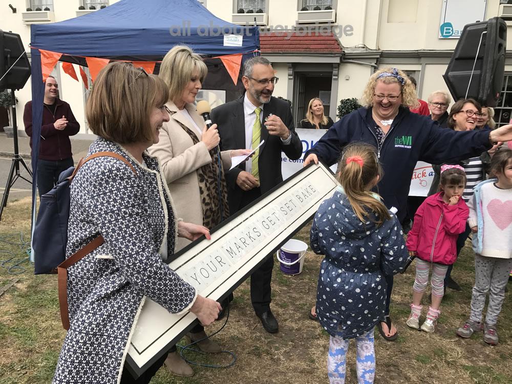 overall-winner-receives-congratulations-weybridge-cake-off