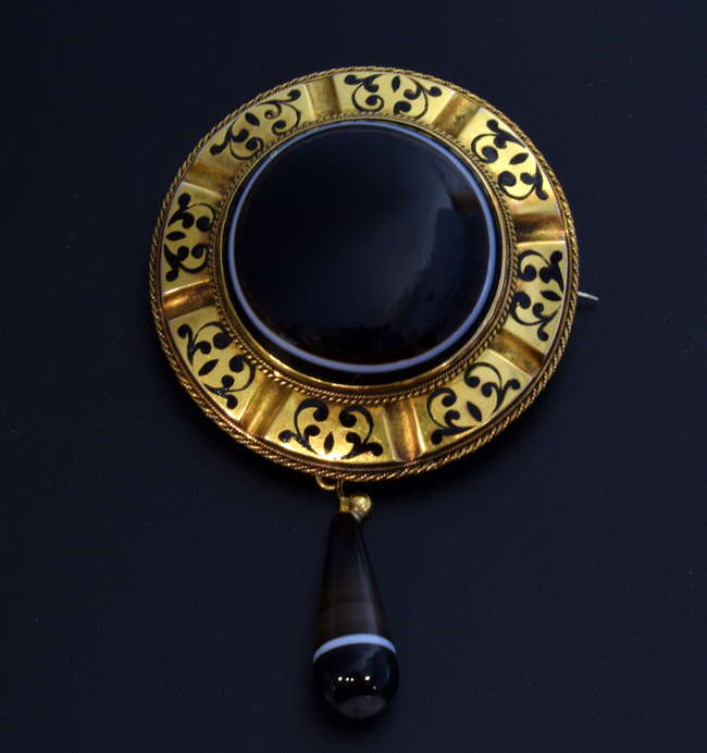 Surrey Jewellery Auction - Victorian mourning brooch, banded agate centre with a black enamel and gold surround