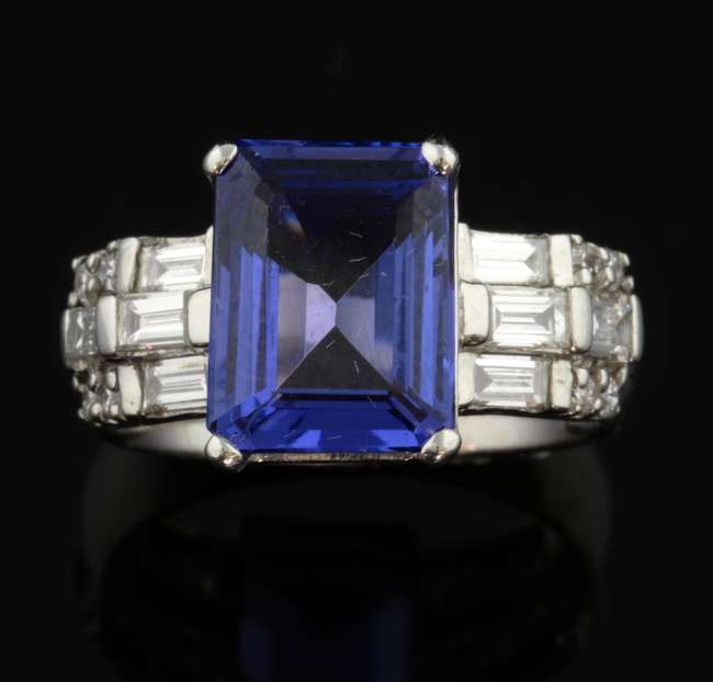 Surrey Jewellery Auction - Tanzanite and diamond dress ring, the step cut tanzanite weighing approximately 4.50 carat with baguette and round brilliant cut diamond set shoulders, mounted in 18 ct white gold