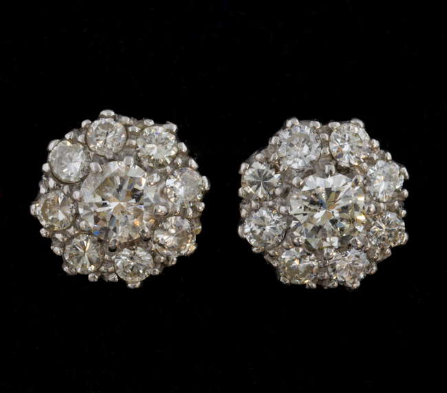 Woking Surrey Antique Jewellery Auction - Pair of diamond cluster earrings, each set with central stone estimated at 0.40 carat, within a border of eight diamonds