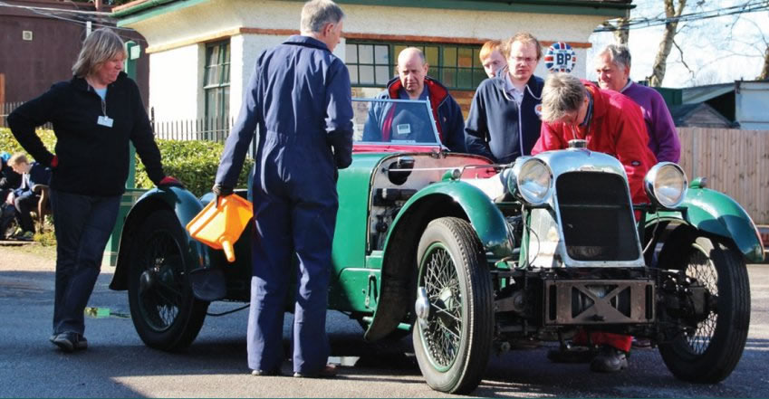 Brooklands Museum Volunteering - Volunteers around Vintage Car