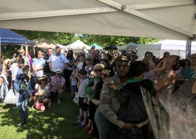 Crowd gathers to hear the results of The Great Weybridge Cake Baking Competition 2018