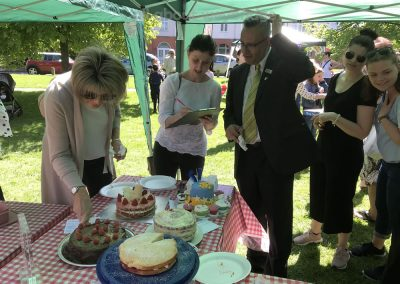 Judges and admiring public at Weybridge Green Surrey Baking Competition