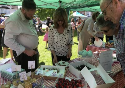 Judges from Morrisons Supermarket and admiring public at Weybridge Green Surrey Baking Competition