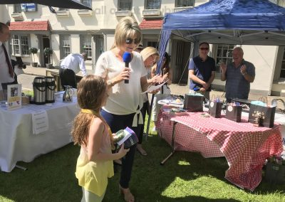 Junior winner of Family Bakes gets prizes from Ruth Langsford at Great Weybridge Cake-off