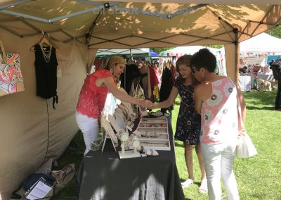 Ladies shopping at Stella and Dot Jewellery and Clothing Stall at the Artisan Market on Monument Green Weybridge Surrey