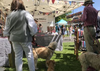 Local dogs are checking out the leads and accessories - browsing with their owners atThe Black Dog Company Stall at the Market in Weybridge Surrey