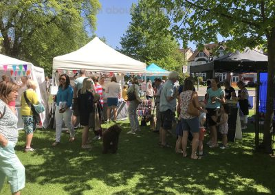 Public enjoy browsing annd shopping at the stalls at the Artisan Market on Monument Green Weybridge Surrey