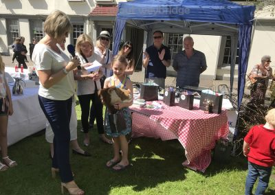 Winner of Celebration Cakes Competition Childrens Category presented with prizes at Weybridge Green Surrey Bake-off