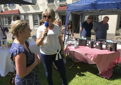 Winner of Small Bakes Competition speaks with Ruth Langsford at Great Weybridge Cake-off