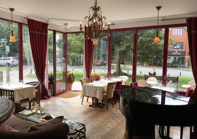 Dining Room and Grand Piano at Meejana Restaurant Weybridge Surrey