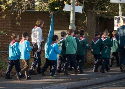 Weybridge Scouts parade from War Memorial to Civil Service at St James Church on Remembrance Sunday