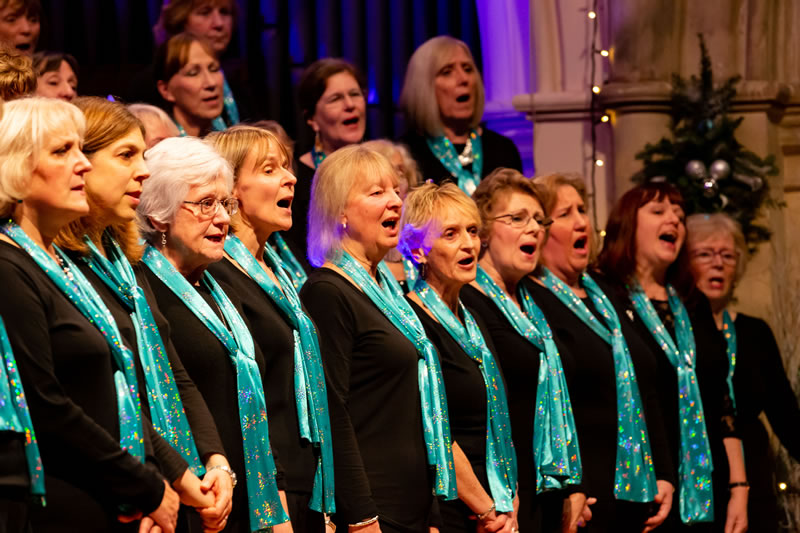 Elmbridge Mixed Choir singing in Woking Christmas Charity Concert