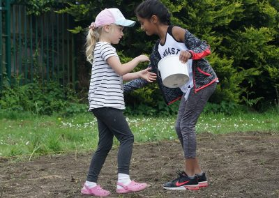 Children sowing seeds - Churchfield Recreation Ground