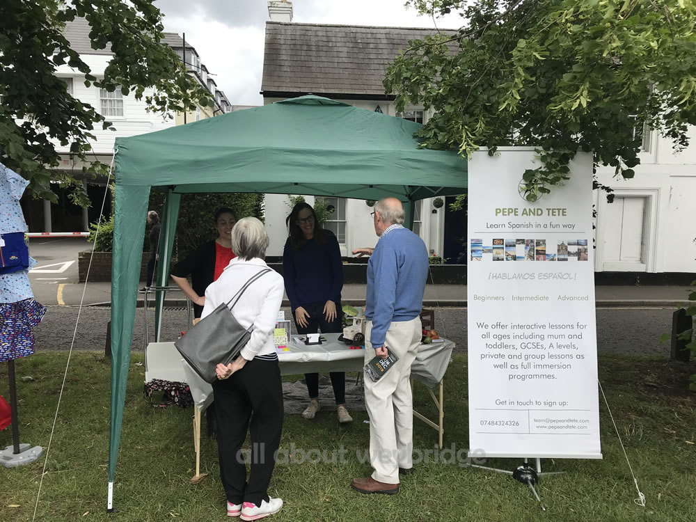 Families enjoy the Community Event in Weybridge on Monument Green