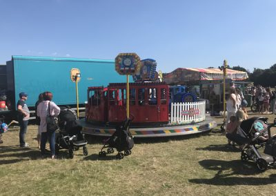 Fairground rides for kids at Brooklands Fun Day Weybridge Surrey