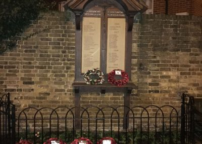 Oatlands Weybridge War Memorial at Night with Wreaths - Remembrance Sunday