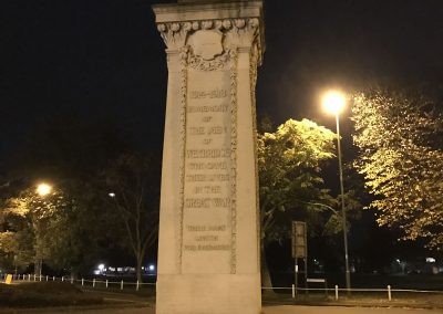 Weybridge War Memorial at Night with Wreaths - Remembrance Sunday