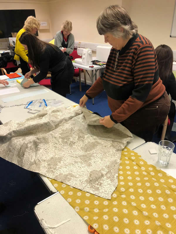 Volunteers Sewing For Binti Charity - Elmbridge Project At Whiteley Village