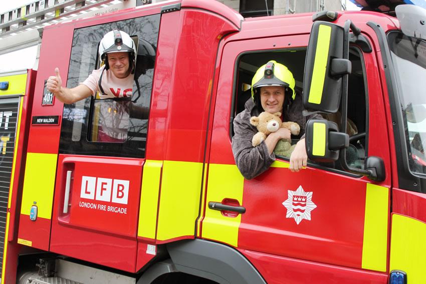London Fire Brigade Staff in Pyjamas at New Malden in Fire Engine