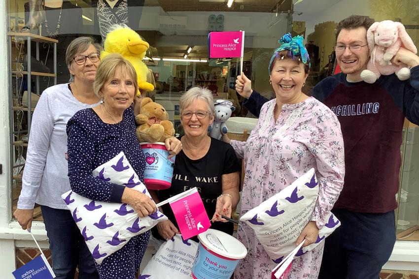 Shop staff in Pyjamas supporting Night Nurses of Princess Alice Hospice Charity