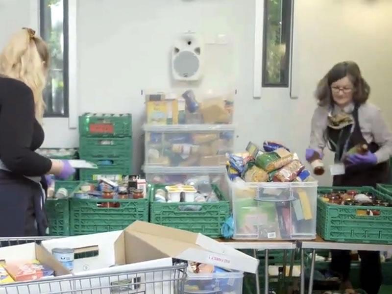 East Elmbridge Foodbank Volunteers Distributing Food