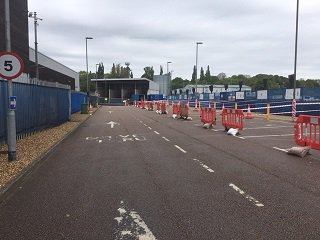 Upon entering the site you will be directed to a lane to wait until a bay becomes available