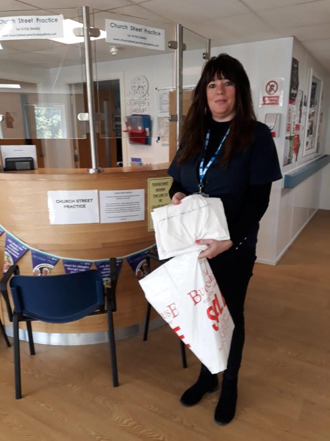 Church Street GP Practice receiving items made by Sew Weybridge