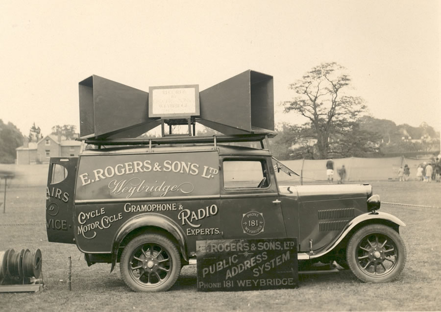 Rogers' van parked with Address System for a local event. C.1930s